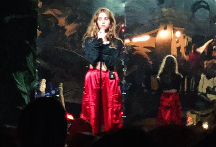 Photograph of Clairo on stage