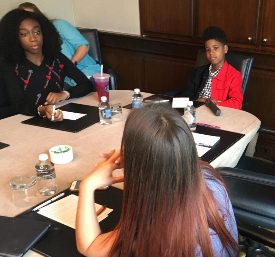 Shahadi Wright Joseph (left) and JD McCrary (right) talk with reporters during an interview for