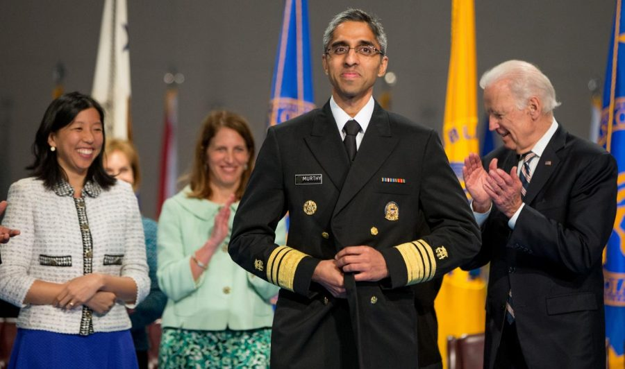 Surgeon General Vivek Murthy, pictured during his 2015 swearing-in ceremony, joined presidential candidate Joe Biden (right) during his remote conference call with voters Monday, March 16, 2020.