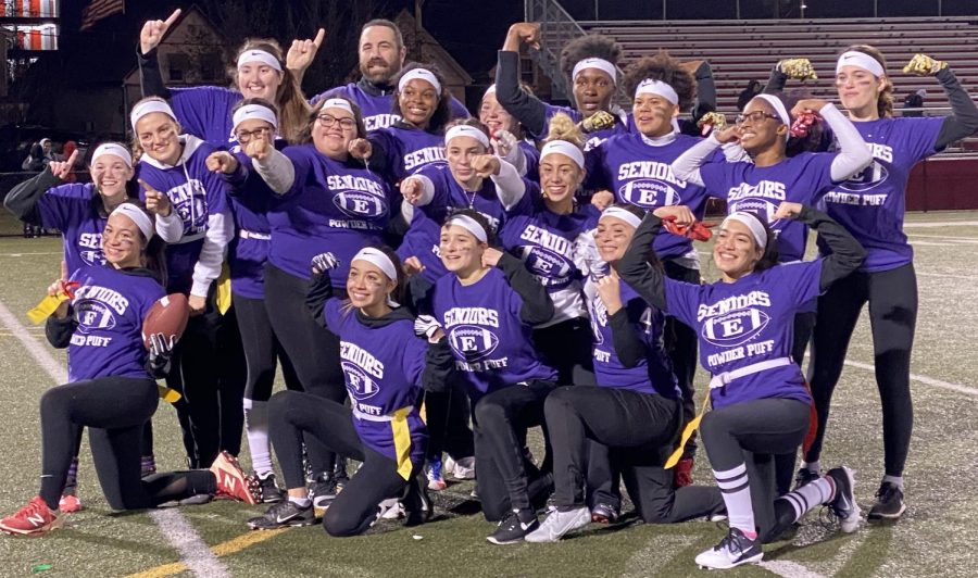 The victorious Purple team celebrates its 2019 powderpuff victory at Everett (Mass.) High