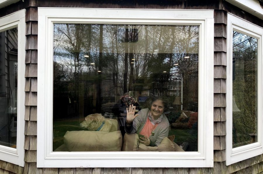 The photographer captures her grandmother, Nancy Hoit, who is sitting in the window of her house in Hingham, Mass., on April 22, 2020.