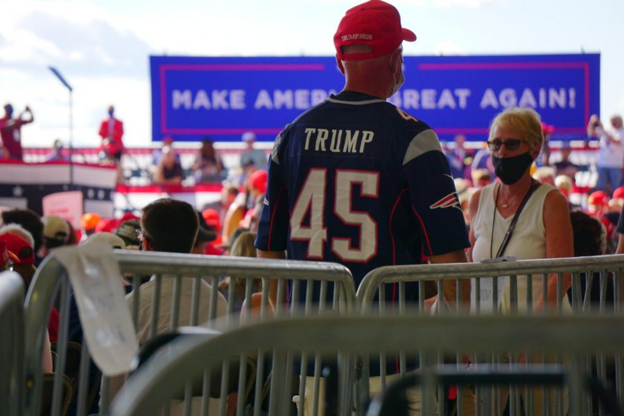 A man wears a Trump-themed New England jersey at a Trump rally in Londonderry, N.H., Friday.
