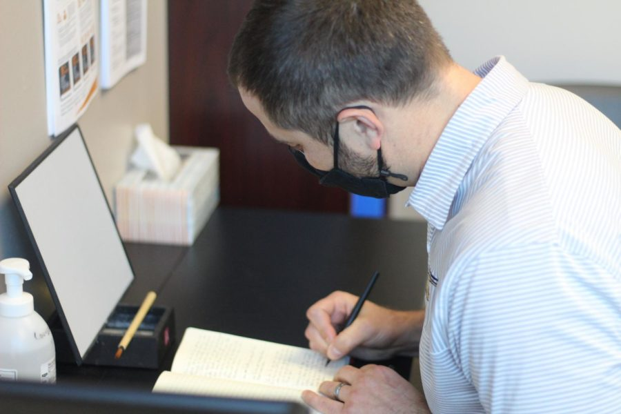 Adam Melichar, a counselor at Maize South High School, writes a letter of recommendation for a senior. In the years he has been teaching and counseling, he has written hundreds of unique letters for his students.