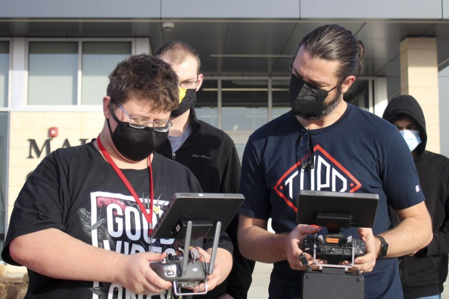This picture by Bridget Johnson of Maize South High in Wichita, Kan., was honored in the category of BEST EDUCATION PHOTO in HiE's April 2021 contest. Here is submitted caption: Aiden Herrington (10), a OneMaize broadcasting student, learns how to fly a drone in front of the Maize Career Academy with instruction from producer Derek Lowrey of Derek Lowrey Video Production. Although Herrington does not use the Hub on a daily basis, he enjoyed watching a professional race drones and learning how to fly drones. (Photo by Bridget Johnson/Bullseye/Maize South)