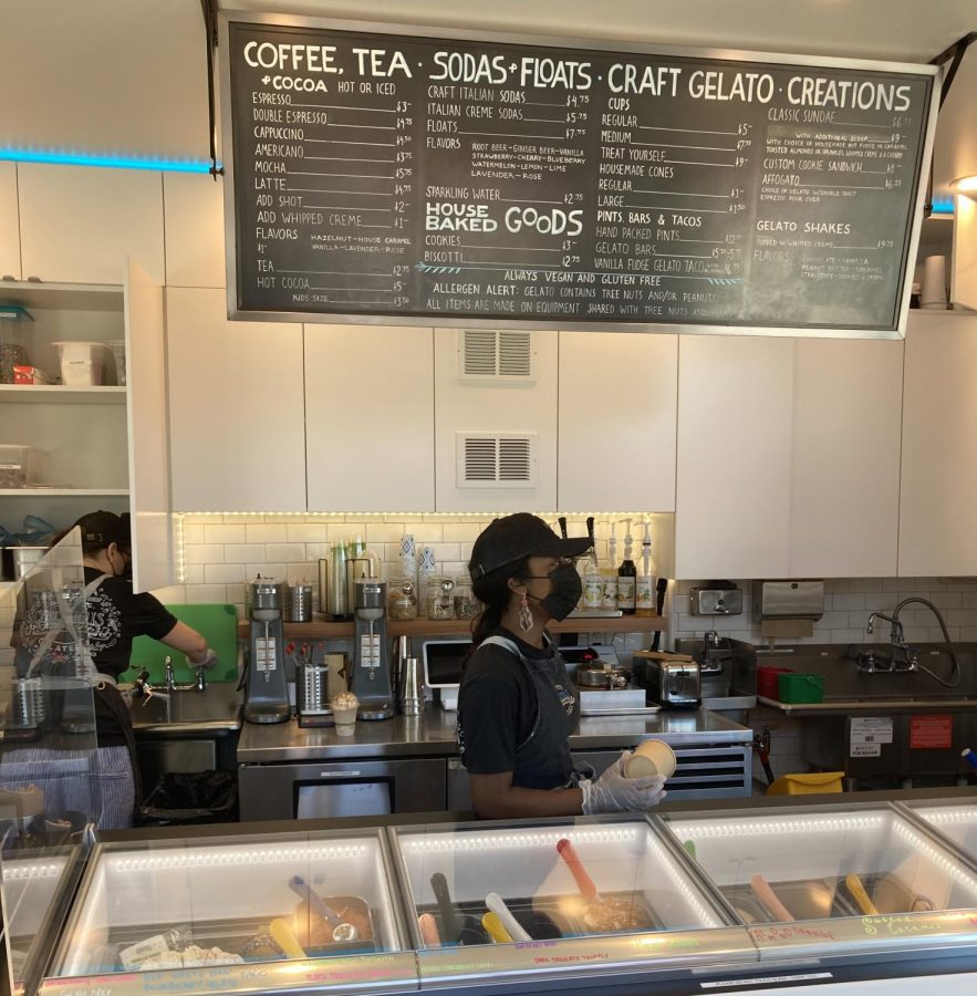 Workers Mars and Savanna take orders and scoop gelato for costumers at Conscious Creamery in Sacramento, Calif.