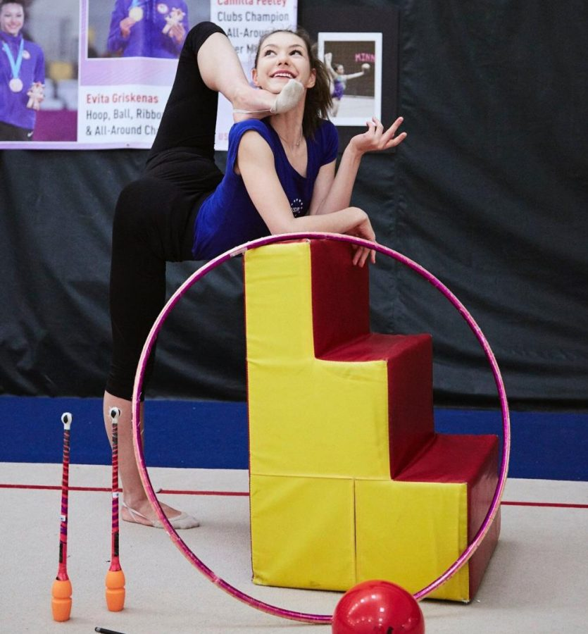 Evita Griskenas, of the US Olympic gymnastics team, poses with some some of the apparatuses she performs with, including the  ball, clubs, and hoop.