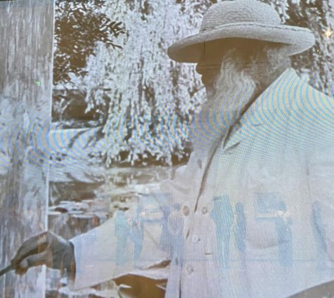 """Still from Ceux de chez nous (Those of our land), a 1915 film by French actor Sacha Guitry. The film shows Monet painting in his gardens in France, and plays at the entrance to """"Monet and Boston: Legacy Illuminated"""" at Boston"""